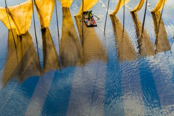 Fishermen close the net. 2016 SkyPixel Photo of the Year